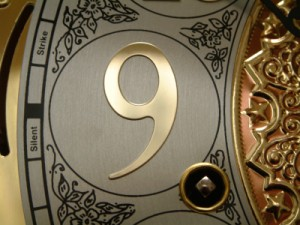 the number 9, detail on a clock face