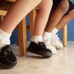 grade school kids legs, socks and shoes