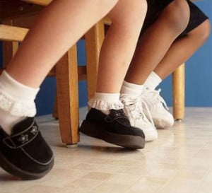 grade school kids legs, socks and shoes